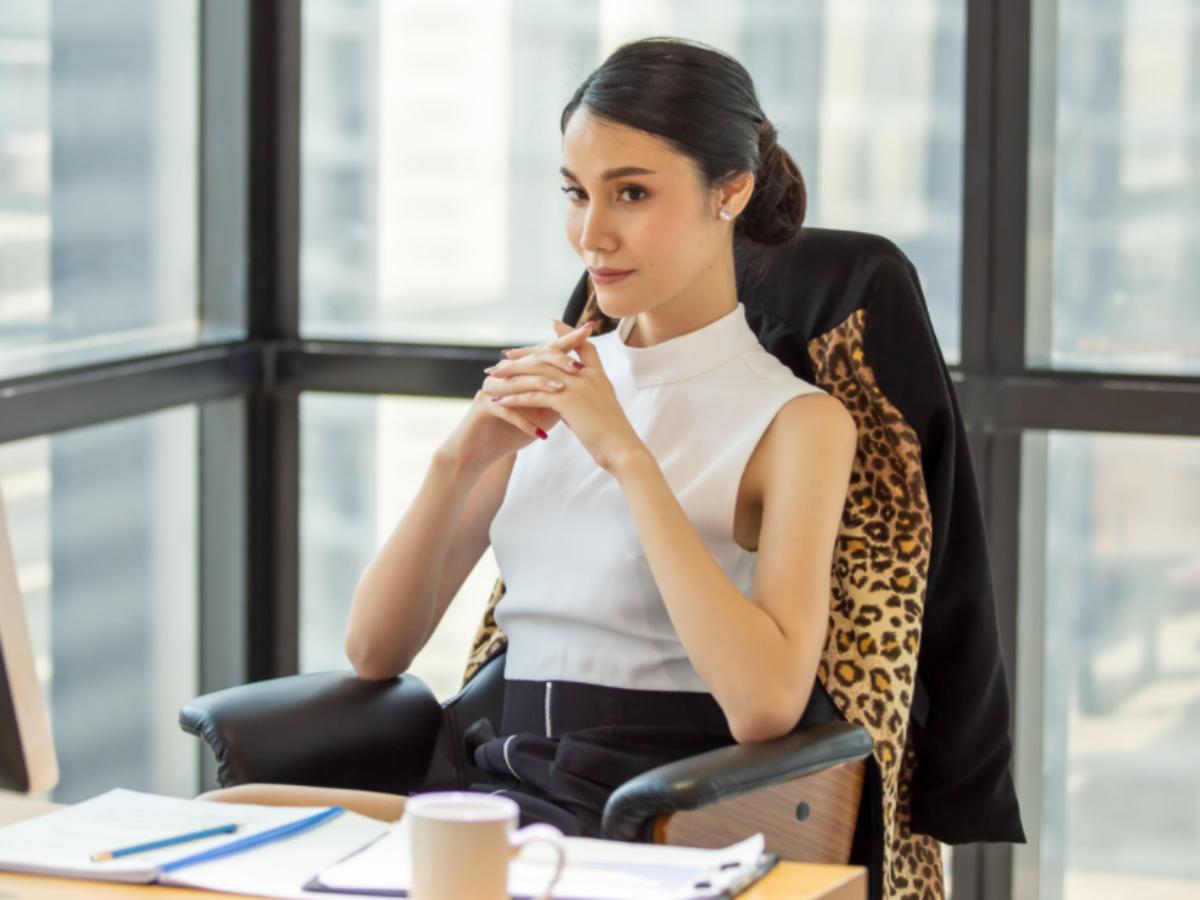 woman seriously thinking at desk